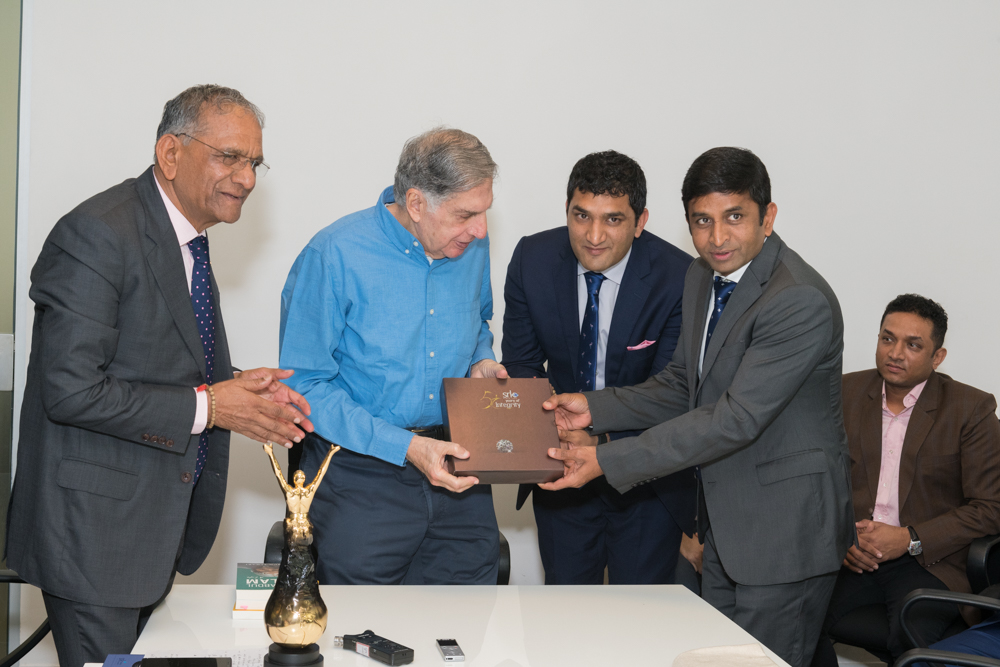 Mr. Tata is presented with the book, 'Nothing to Everything' by Rahul Dholakia and Shreyans Dholakia