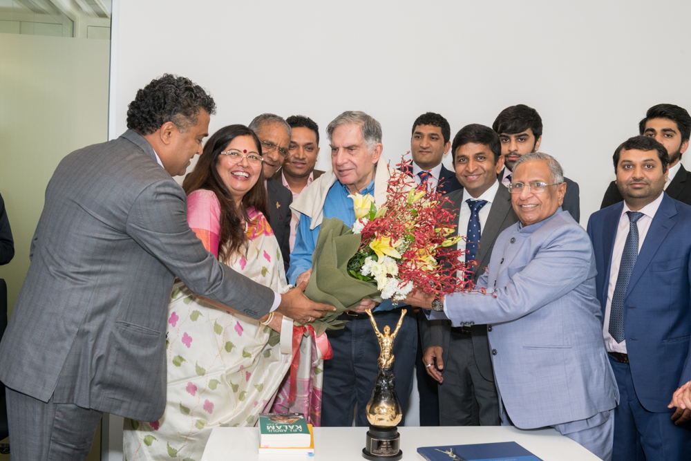 GIA M.D. Mrs. Nirupa Bhatt and Mr. Navin Mehta presenting bouquet to Mr. Tata